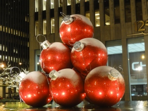 Giant ornaments on sixth avenue lightly covered with snow!