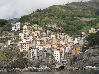 The Cinque Terre villages look intricately balanced between the mountains and the Sea.