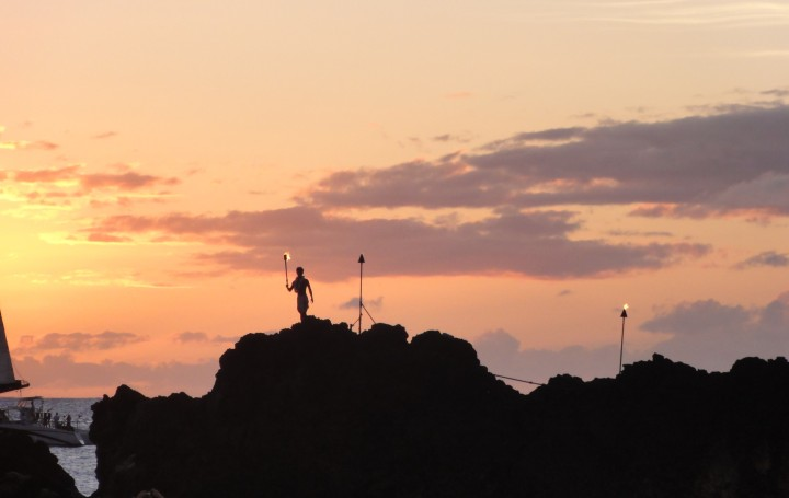 "A hawaiian ""warrior"" getting ready to do the cliff dive from Black Rock, Kaanapali, Maui"