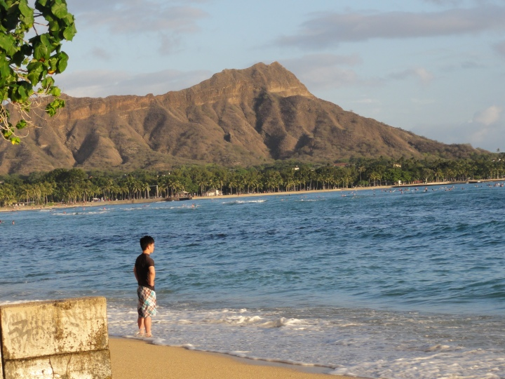 The Diamond Head crater and the Waikiki beach in Honolulu, Hawaii. The beach was so crowded that I was not possible to take even one picture of this dormant volcano without a fellow tourist!
